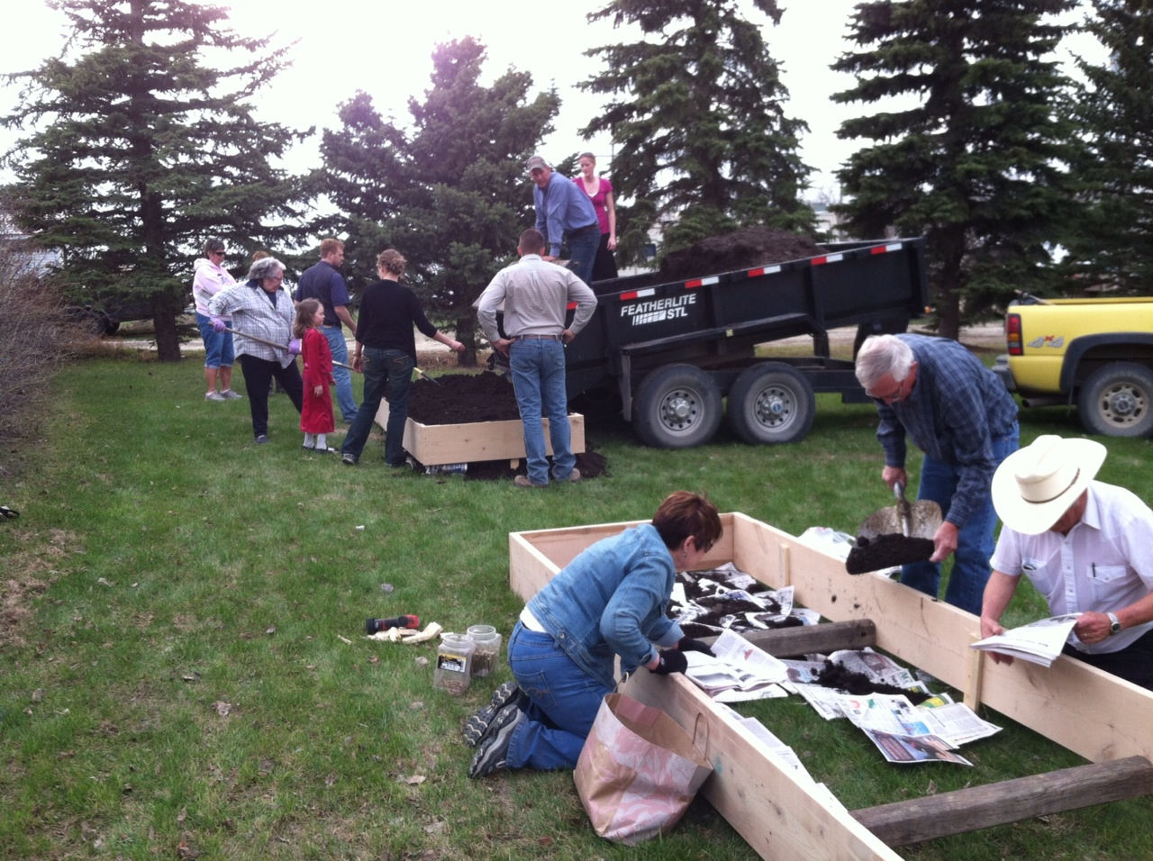 The people came together to build garden boxes out behind the church.